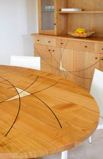Mirror image - table decorated to match cabinet