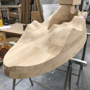 Assembly taking place - solid carved - table base