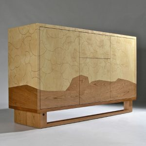 Storage cabinet featuring marquetry and engraved lines to detail a cloud pattern