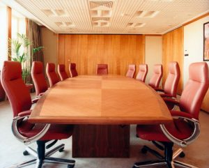 Boardroom table made in American cherry with walnut solid edge details