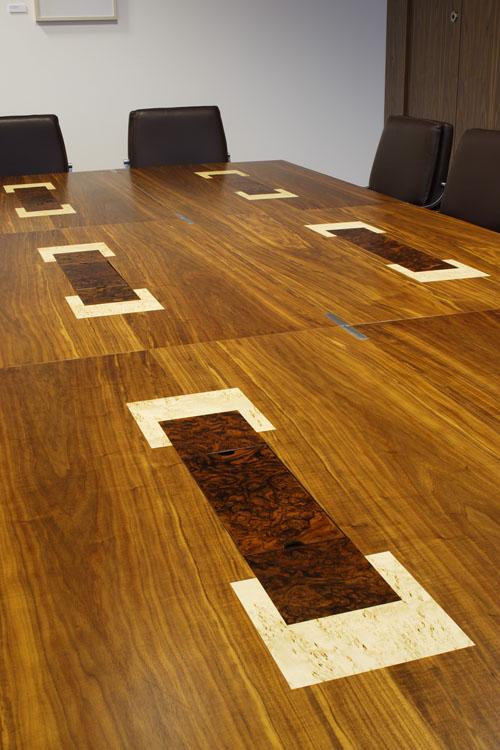 Riverside- Modular boardroom tables in American black walnut with burr walnut and masur birch inlays