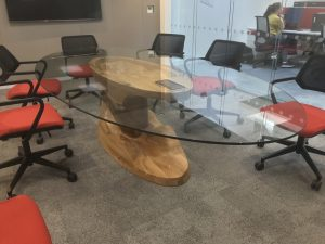 Bespoke meeting table with CNC 3D machined terrain inspired oak base and glass table top
