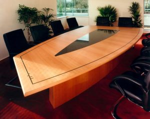 Boardroom table in Steamed Beech with ebony inlays and Black Granite inset. Seats 12