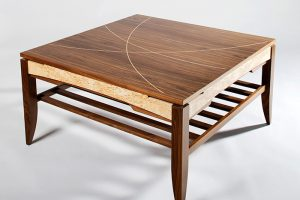 Coffee table in solid and veneered walnut with masur birch details and maple inlays.