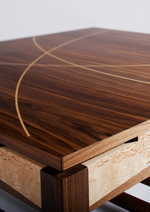 Detail of Coffee table in solid and veneered walnut with masur birch details and maple inlays